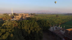 Hot air ballooning over the Luxor and Nile river. Stock Footage