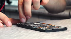 Technician's hands adjusts a component with a small screwdriver Stock Footage