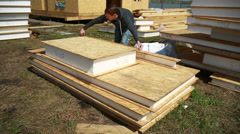 A man building a house. foam polystyrene. blocks made of plywood and insulation Stock Footage