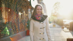 Portrait of a pretty smiling female on the spring street slow motion Stock Footage