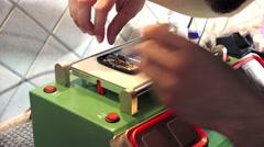 Smartphone technician fixs smart card in a mobile Stock Footage