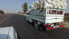 Pick-up truck on the road in Aswan, Egypt Stock Footage