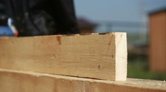 Carpenter cut wood for house construction Stock Footage