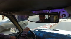 Taxi driver driving female tourist through Aswan Stock Footage