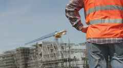 Site manager observe his construction yard   - stock footage