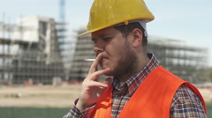 Construction worker while smoking a cigarette during the break Stock Footage