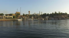 Boats on the Nile river in Aswan at sunset Stock Footage