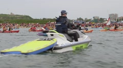 Climate change protester kayaks - port blockade - police on jetskis Stock Footage