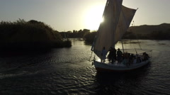 Tour boats on Nile river in Aswan at sunset Stock Footage