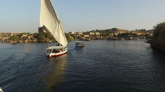 Tour boats on Nile river in Aswan Stock Footage