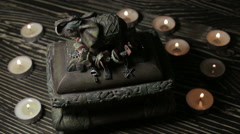A figurine of an elephant by candlelight Stock Footage