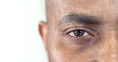 Extreme Close-Up of a Brown Eye of an Afro-American Man - stock footage
