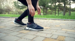 Close up woman tying the shoelaces slow motion Stock Footage