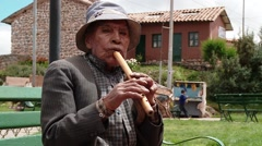 PERU: Busker in a village in Peru. HD Video footage. Chincheros, April 2014 - stock footage