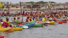 Global warming protest - kayak demonstrators close coal port - stock footage