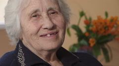Toothless elderly woman smiling happily to the camera Stock Footage