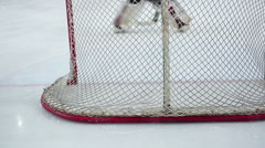 Goaltender preventing puck from entering team's net, repulsing rival attack Stock Footage