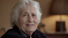 Old lady nods and smiles to the camera Stock Footage