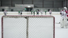Hockey teams end practice match, defocused players and referee leaving ice rink Stock Footage