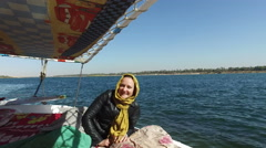 Female tourist relaxing on felucca on the Nile. Stock Footage