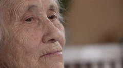 Wrinkled senior woman face Stock Footage
