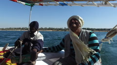 Nubian felucca sailing crew on trip on the Nile. Stock Footage