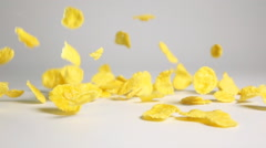 Cornflakes fall on white surface Stock Footage