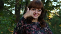 Beautiful attractive young girl shows Gesture Of Approval  Stock Footage