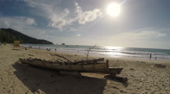 Tropical Beach Ocean Shore Old Boat, Kids Playing in the Sea - stock footage