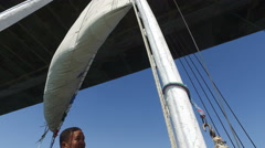 Sailing felucca under Aswan bridge Stock Footage
