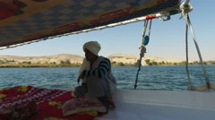 Nubian felucca sailing crew man on the Nile. Stock Footage