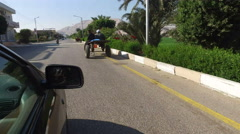 Local people riding donkey cart on the road in Luxor - stock footage