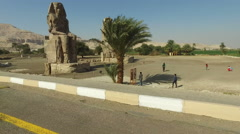 Pharaoh Amenhotep III's Sitting Colossi of Memnon statues at Luxor, West Bank - stock footage