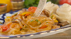 Eating glass noodle stir fry with vegetable Stock Footage