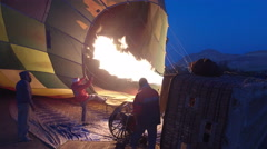 A burner directing a flame into the envelope of a hot air balloon in Luxor Stock Footage