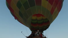 Hot air balloon ascend into the sky from parking lot in Luxor Stock Footage