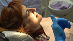 Dentistry Young Woman, Pain Relief and Sealing - stock footage