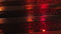 Rainy night in the city. Reflection of traffic lights changing from red to green Stock Footage