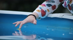 Sad Young Girl Caress a Flower in a Swimming Pool - stock footage