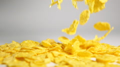 Cornflakes topple on white surface Stock Footage