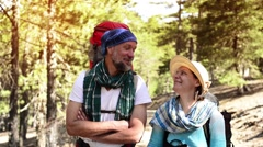 Couple during travel, hiking, standing on trail in forest Stock Footage