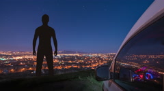 The man stand near the car against the background of night city Stock Footage