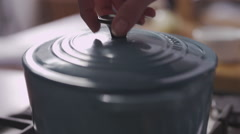 Cooking - Opening pot to view Casserole Stock Footage