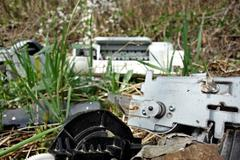 Discarded electronic appliances free standing in nature Stock Photos