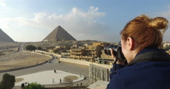 Woman taking photos of beautiful Giza pyramids complex Stock Footage