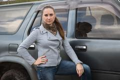 Girl and SUV Stock Photos