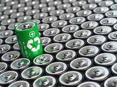 Battery recycling concept. Green energy, Background from battaries and one wi - stock illustration