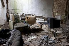 Funny, desolte living and TV room in abandoned building Stock Photos