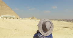 Woman taking photos of Great pyramid of Giza - stock footage