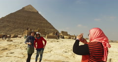 Tourists taking photos in front of Pyramid of Khafre Stock Footage